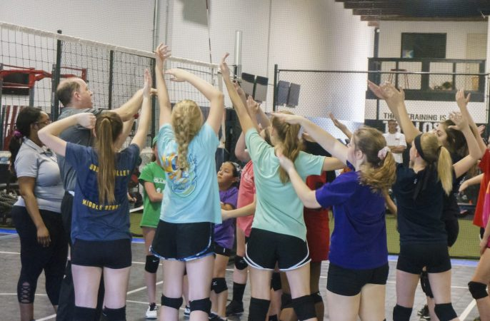 Kansas City North's Eclipse Volleyball Training session - coach charles and diane demontrate
